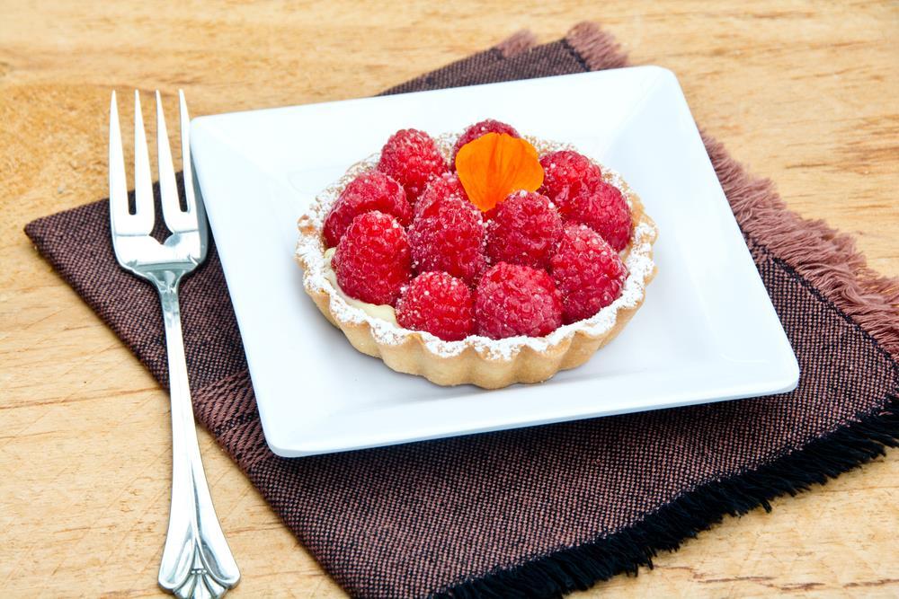 Raspberry tarts with a single nasturtium petal