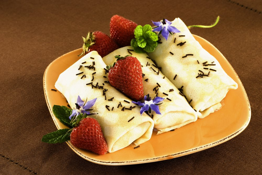 crepes with strawberries and borage accents