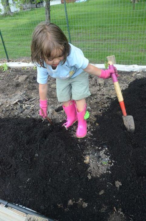 Emma working hard in the garden!
