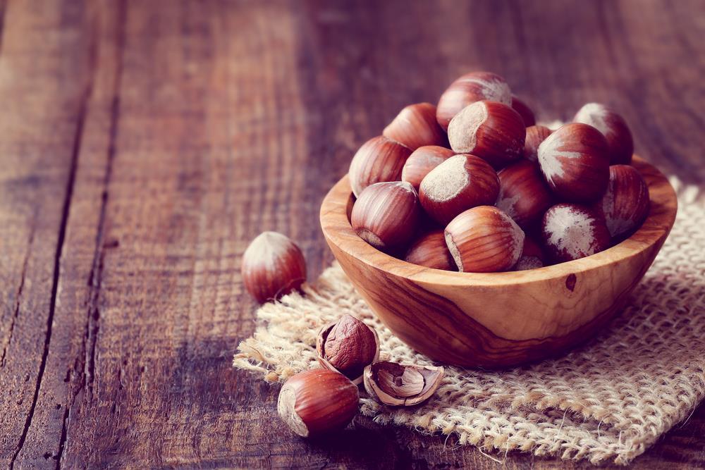 Hazelnuts in wood bowl
