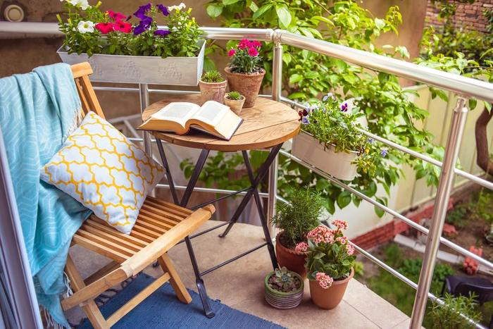 outdoor balcony garden in the city with pansies