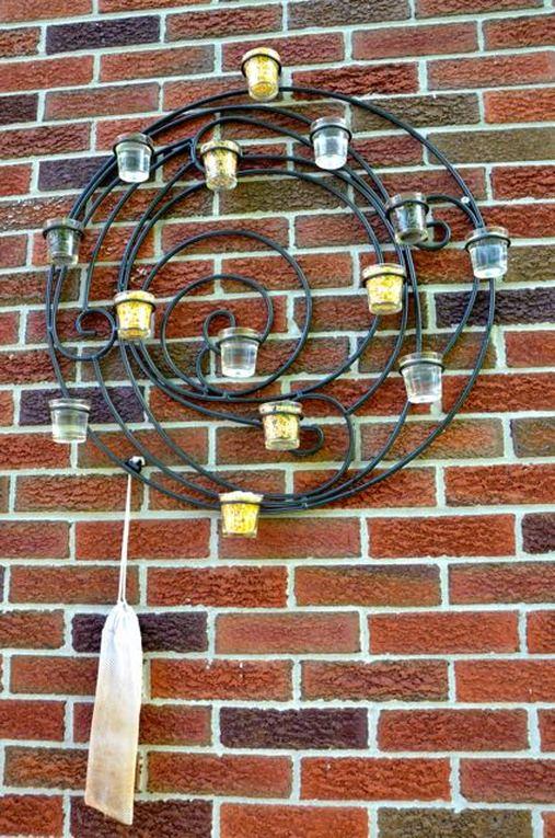 circular wall sconce turned bird feeder