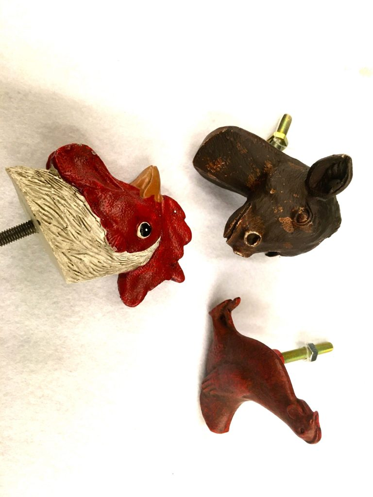 Knobs with farm animals creates a rustic kitchen