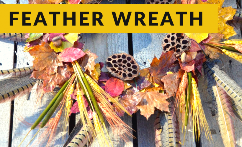 Fall pheasant feather wreath with wheat, cattails, nuts and lotus pod seeds.