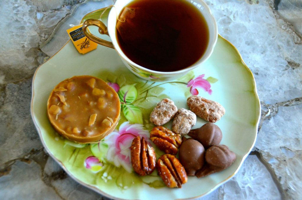 afternoon tea with pralines and nuts as a snack