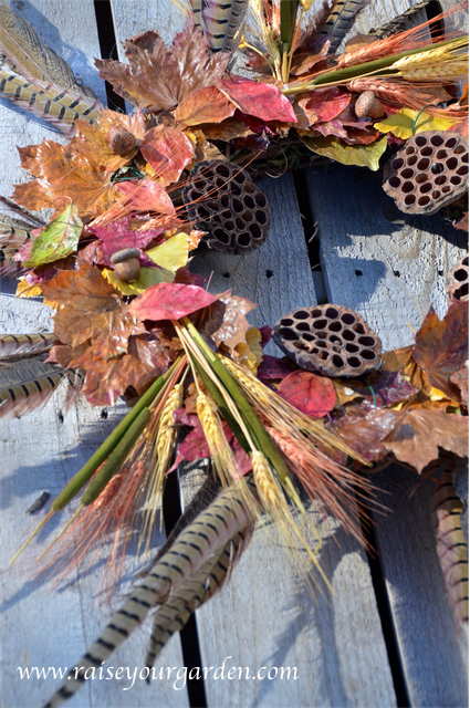 fall pheasant feather wreath with wheat, acorns, lotus seeds pods and dried leaves
