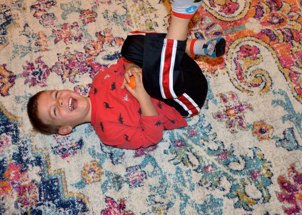 Silly Timothy on area rug.