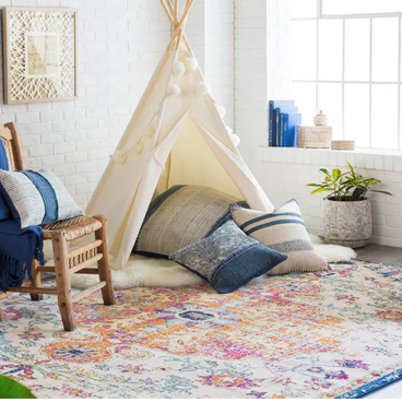 area rug with tent and pillows