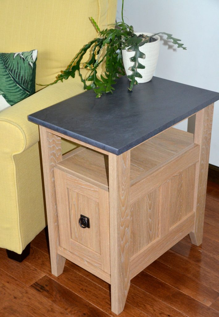 Side table with a non porous top