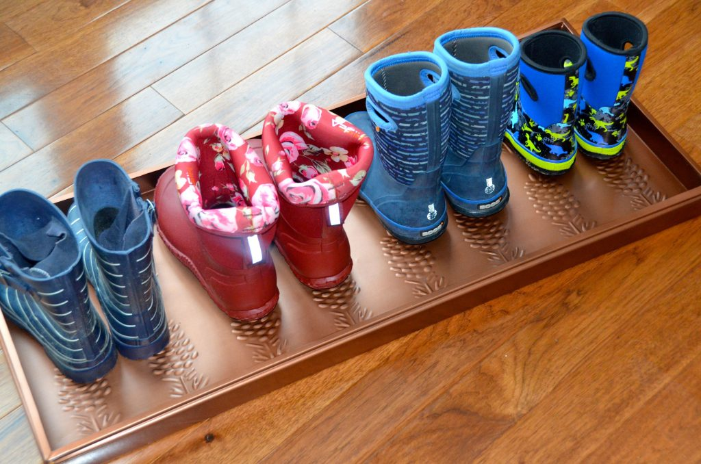 Boots stored on a boot tray