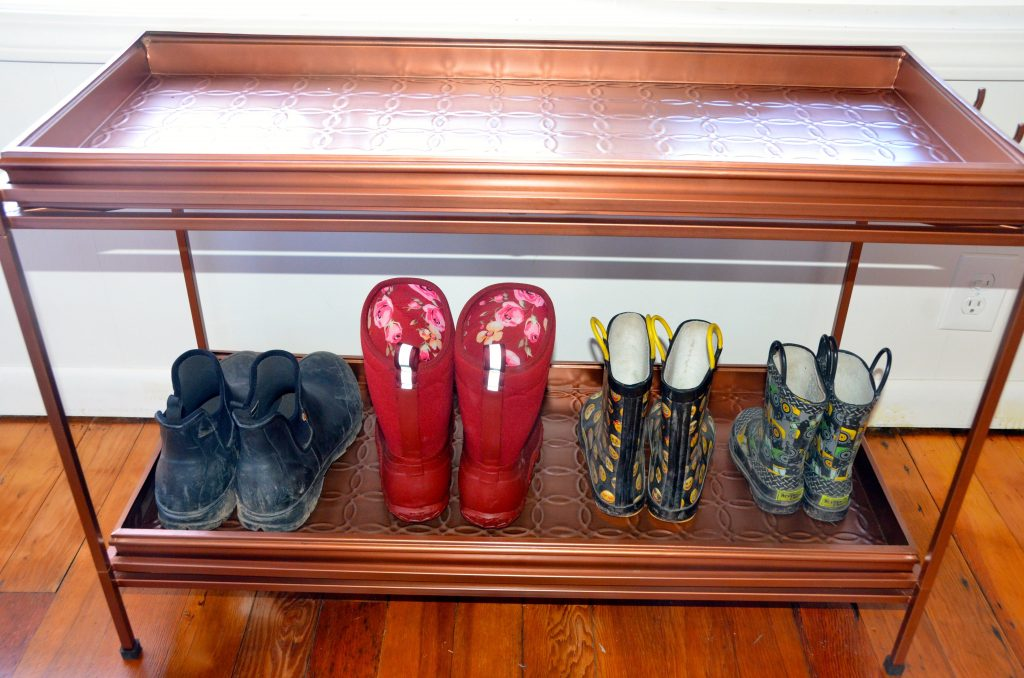 Boots lined up on boot tray